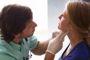 examining-neck-lymph-nodes